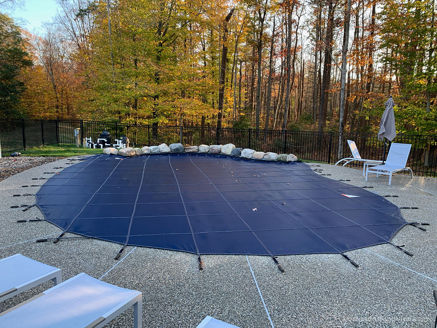 Custom gunite pool by top New England pool company SSG Pools & Spas with pool cover