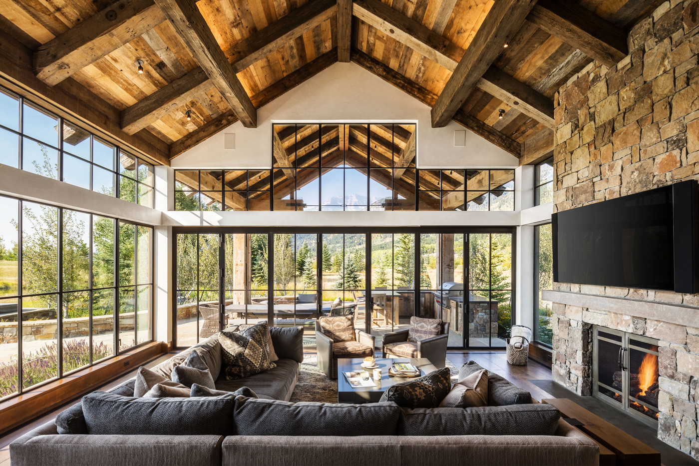 Family room with floor to ceiling windows