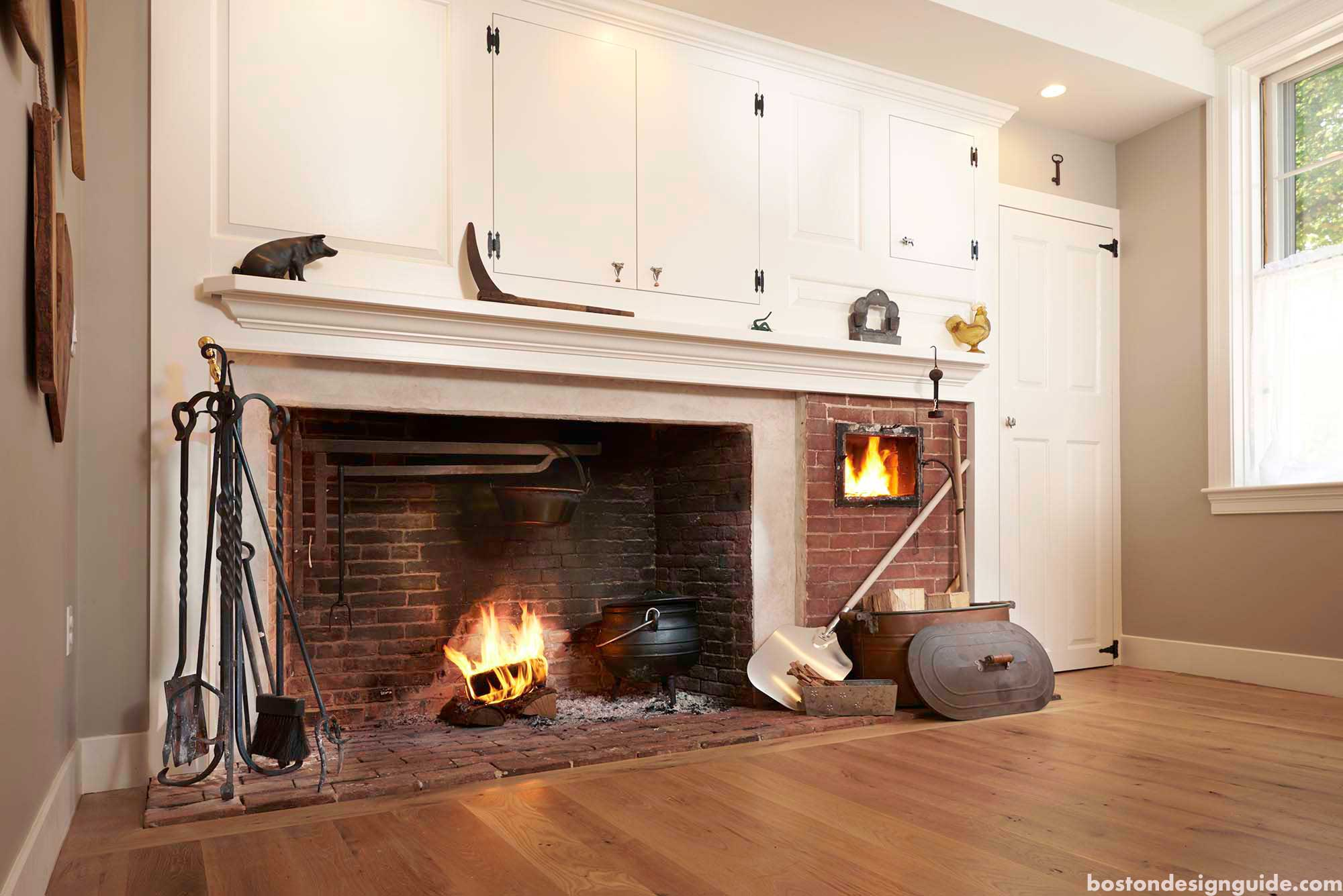 Kitchen fireplace by C2MG Builders