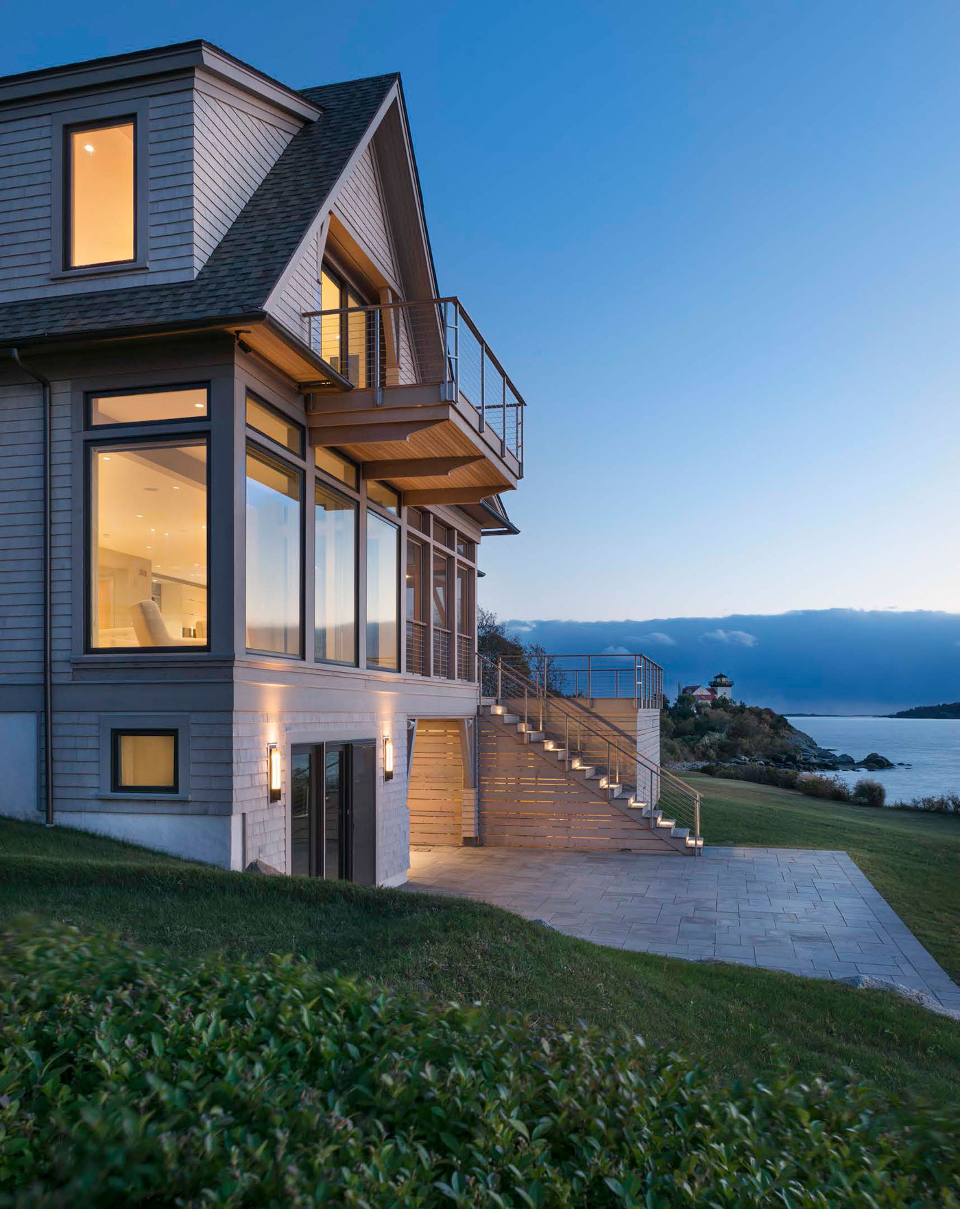 back view of beautiful home along the water