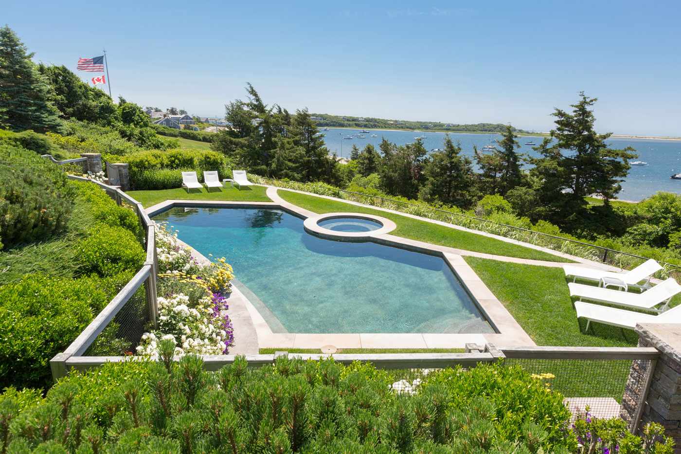 Seaside pool terrace by high-end landscape professionals The Schumacher Companies