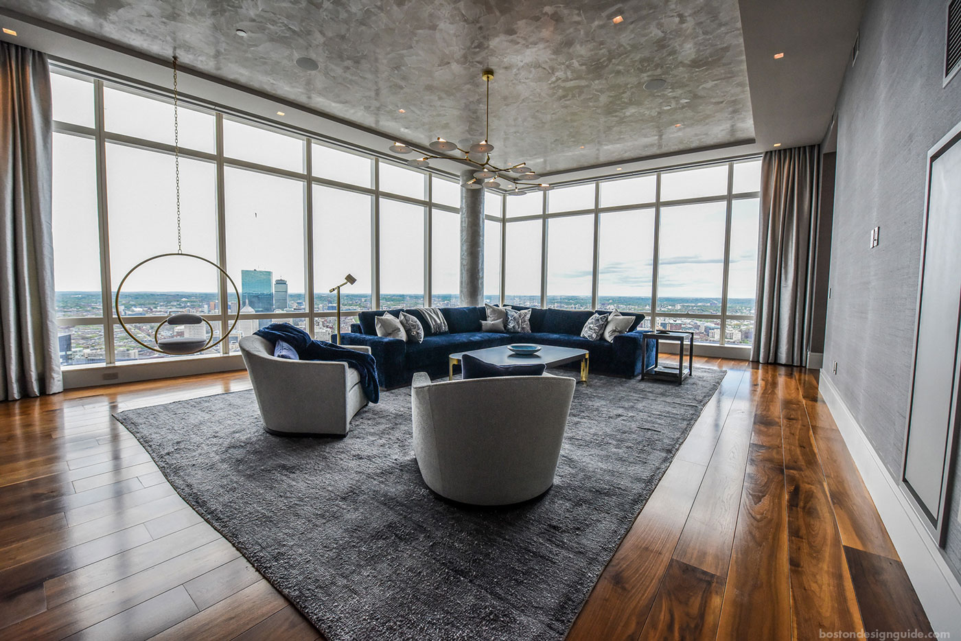 Navy living room set in penthouse apartment