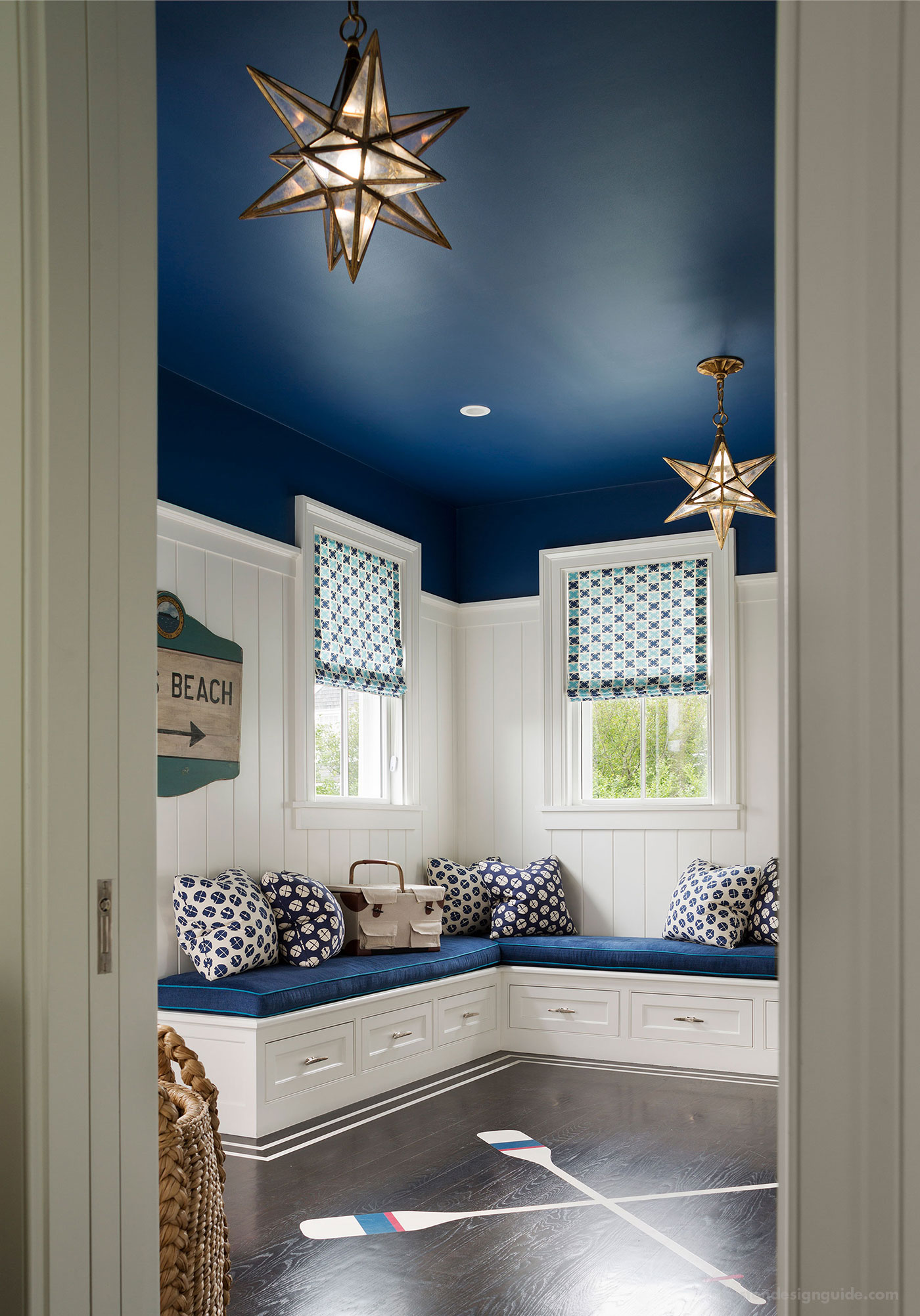 Nautical blue and white entryway designed by SLC Interiors