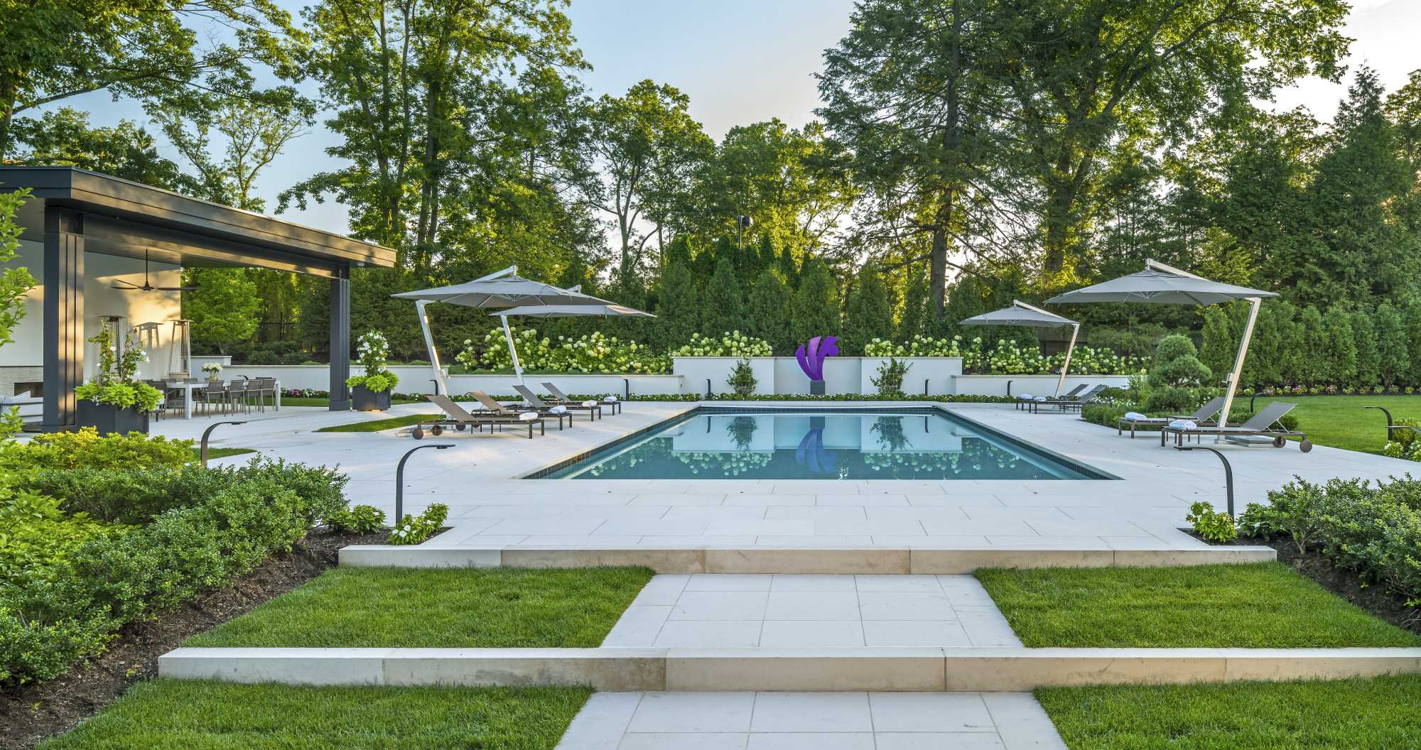 Contemporary pool terrace by landscape architects Sudbury Design Group