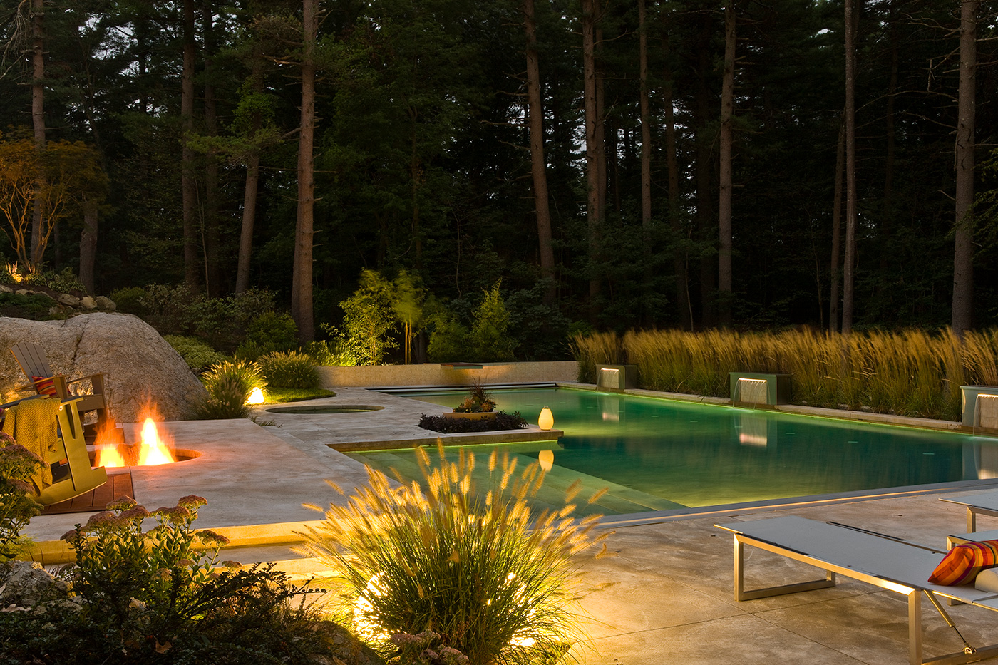 Contemporary pool terrace and garden by Sudbury Design Group