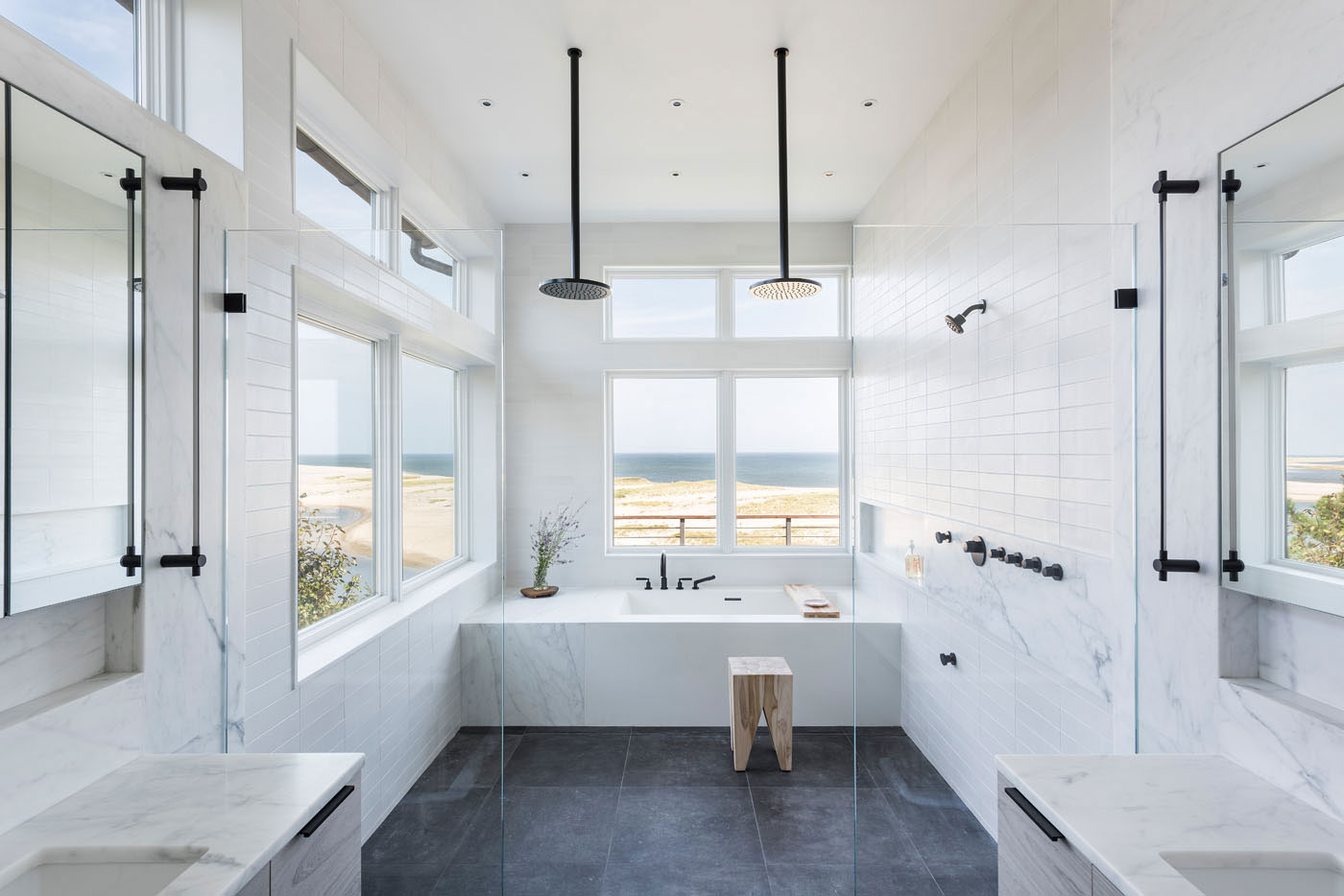 Wetroom bathroom design for a modern oceanfront Cape home built by S.J. Overstreet Construction Co., Inc.