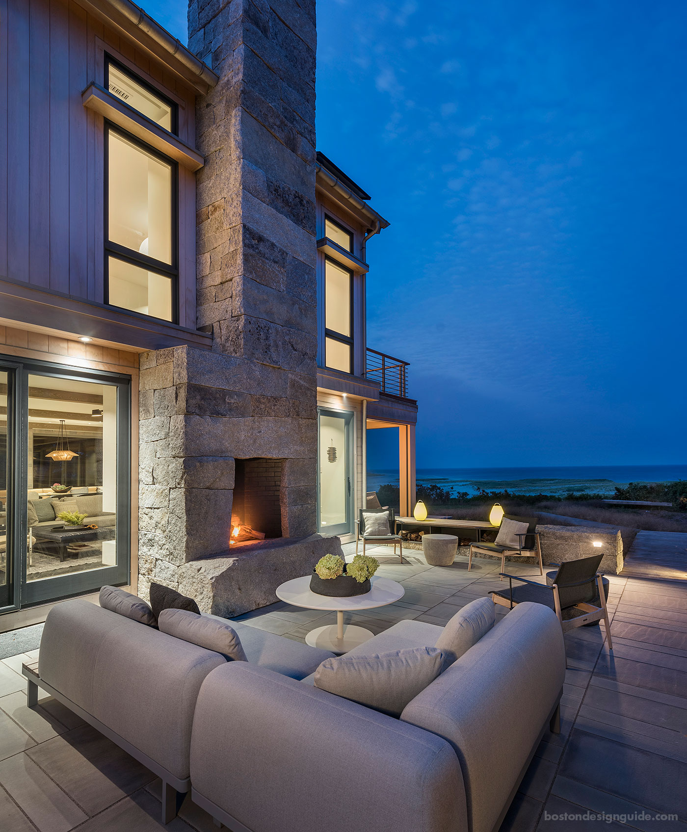 Organic beachside terrace with fireplace, designed by SiteCreative landscape architects