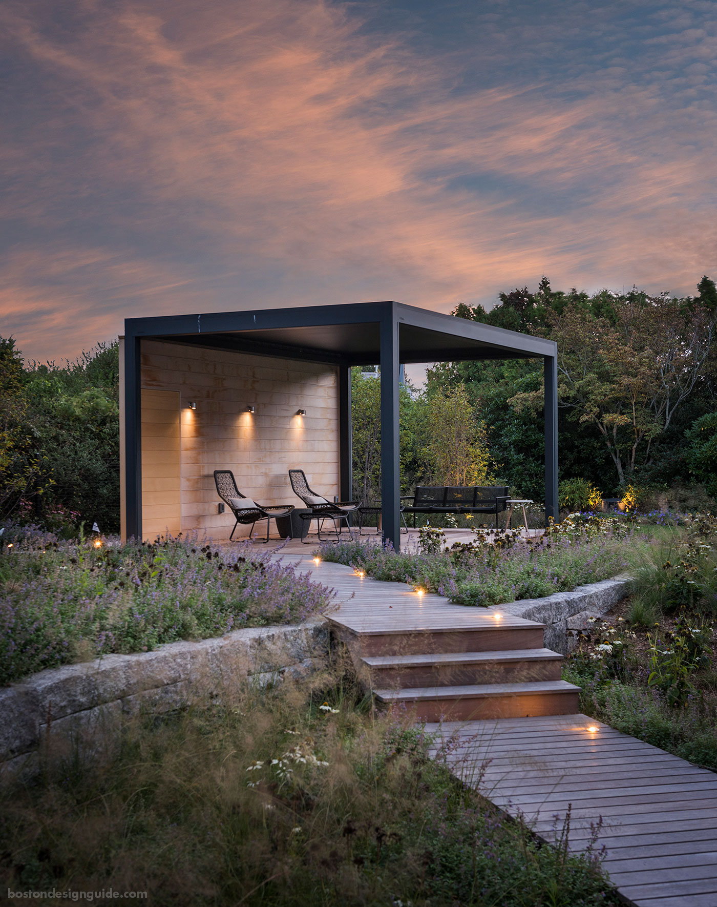 Screened pergola within a coastal meadow designed by SiteCreative landscape architecture and constructed by Schumacher Companies