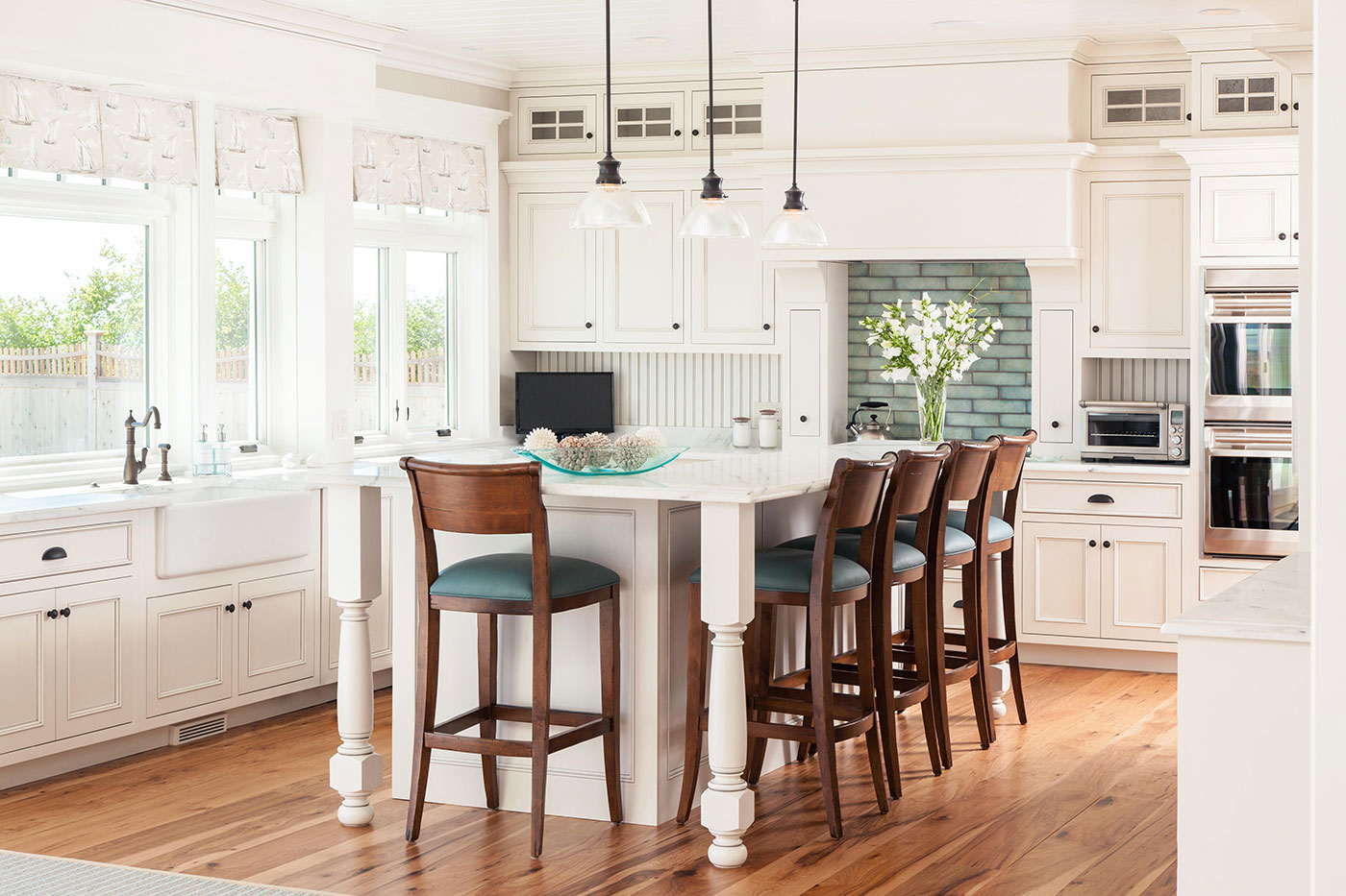 Custom coastal kitchen design by Surroundings Custom Interiors