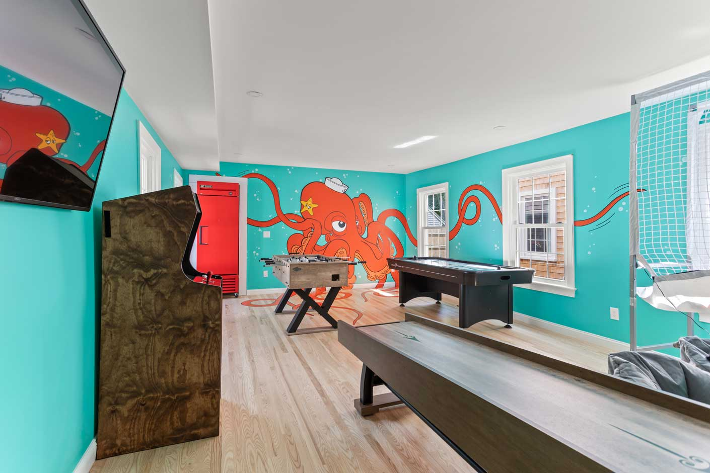 game room with octopus painted on the wall