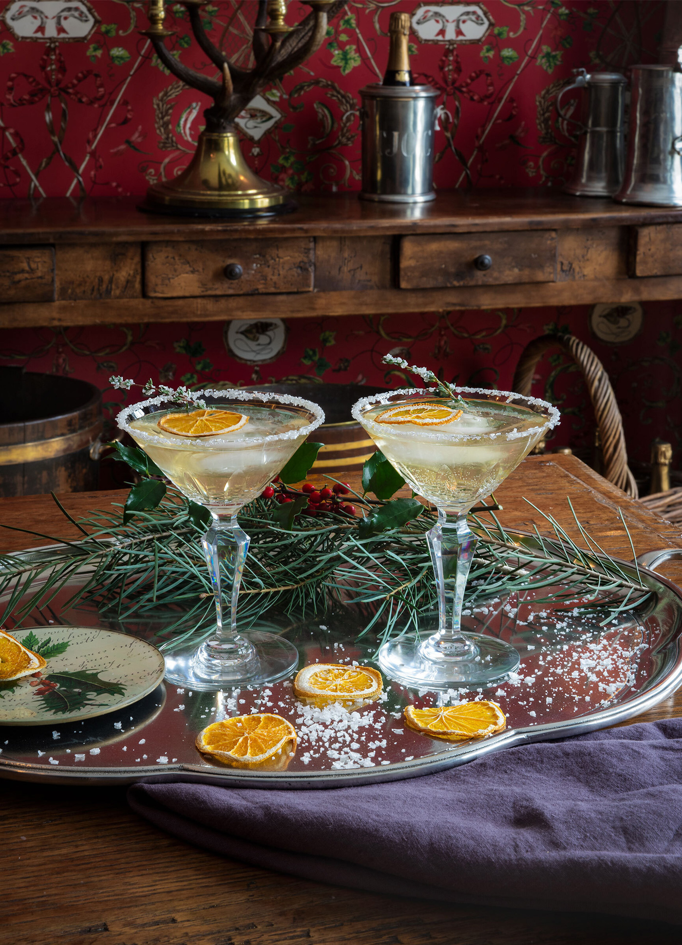 festive holiday drinks on a pewter tray