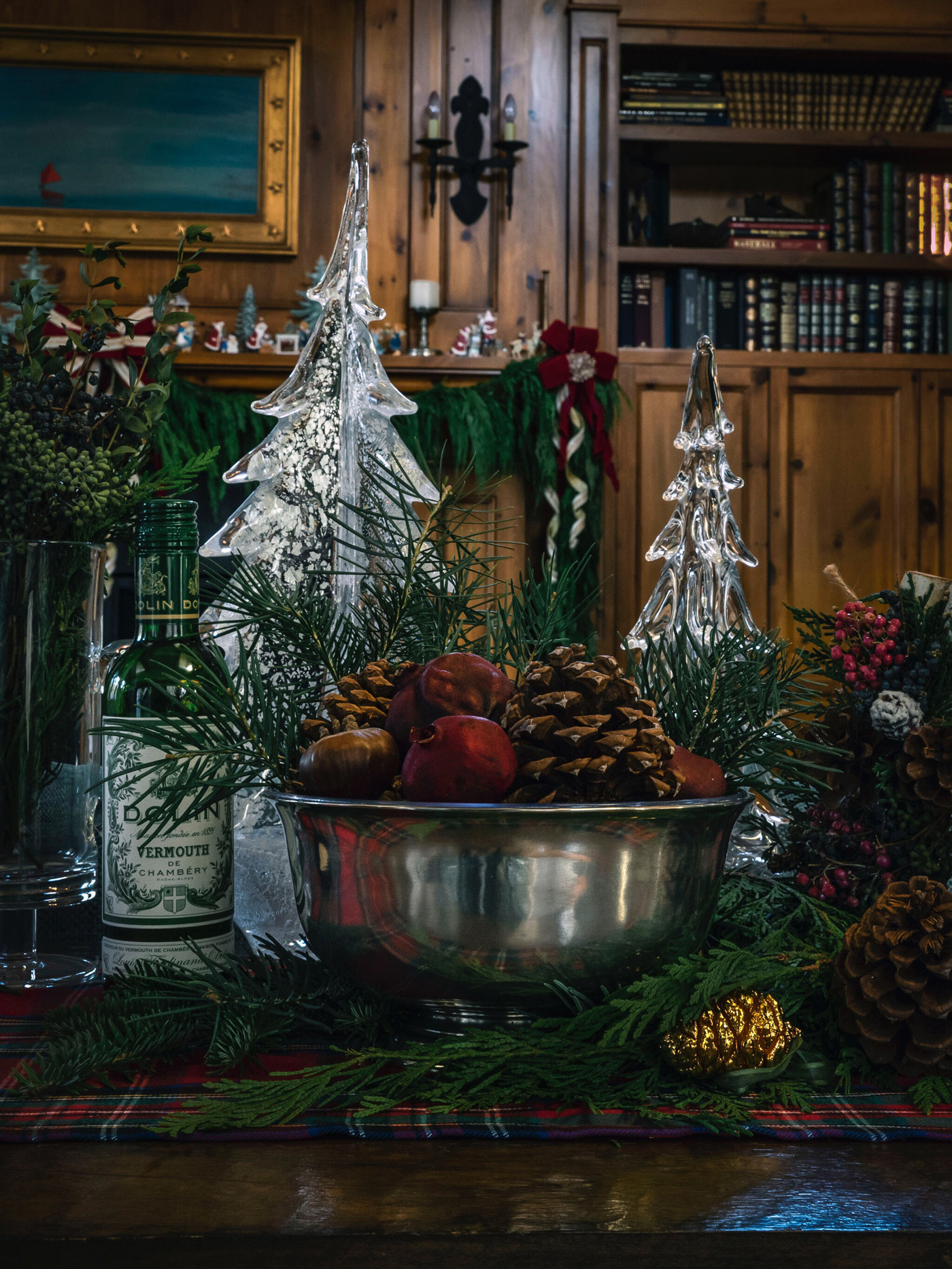 Pewter bowl filled with ornaments and pinecones