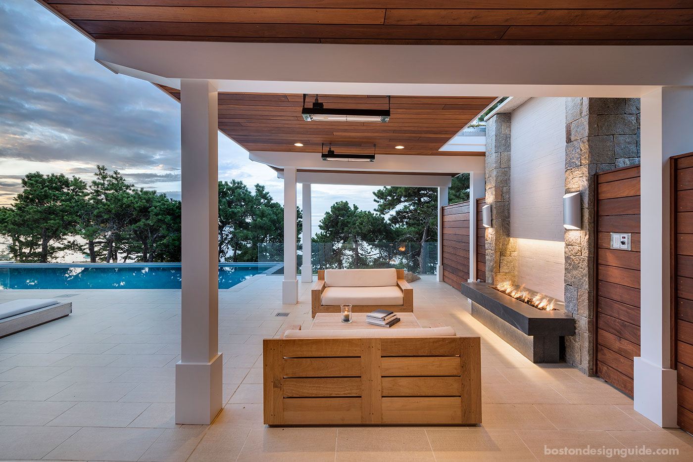Pool terrace with fire feature and heat lamps by ZEN Associates, Inc.
