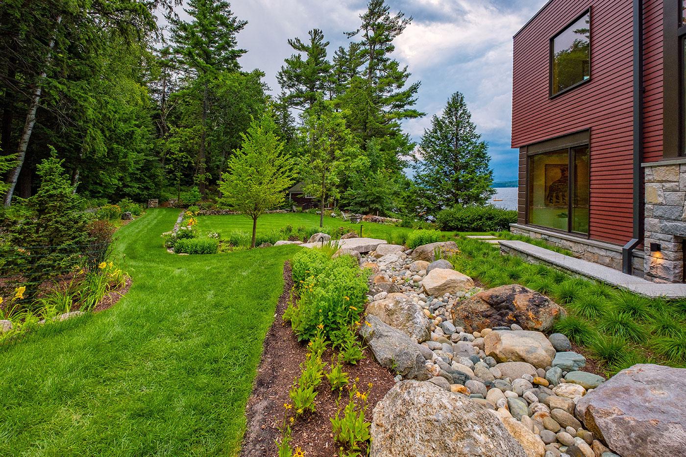High-end landscape with water view by landscape design/build firm Pellettieri Associates, Inc.