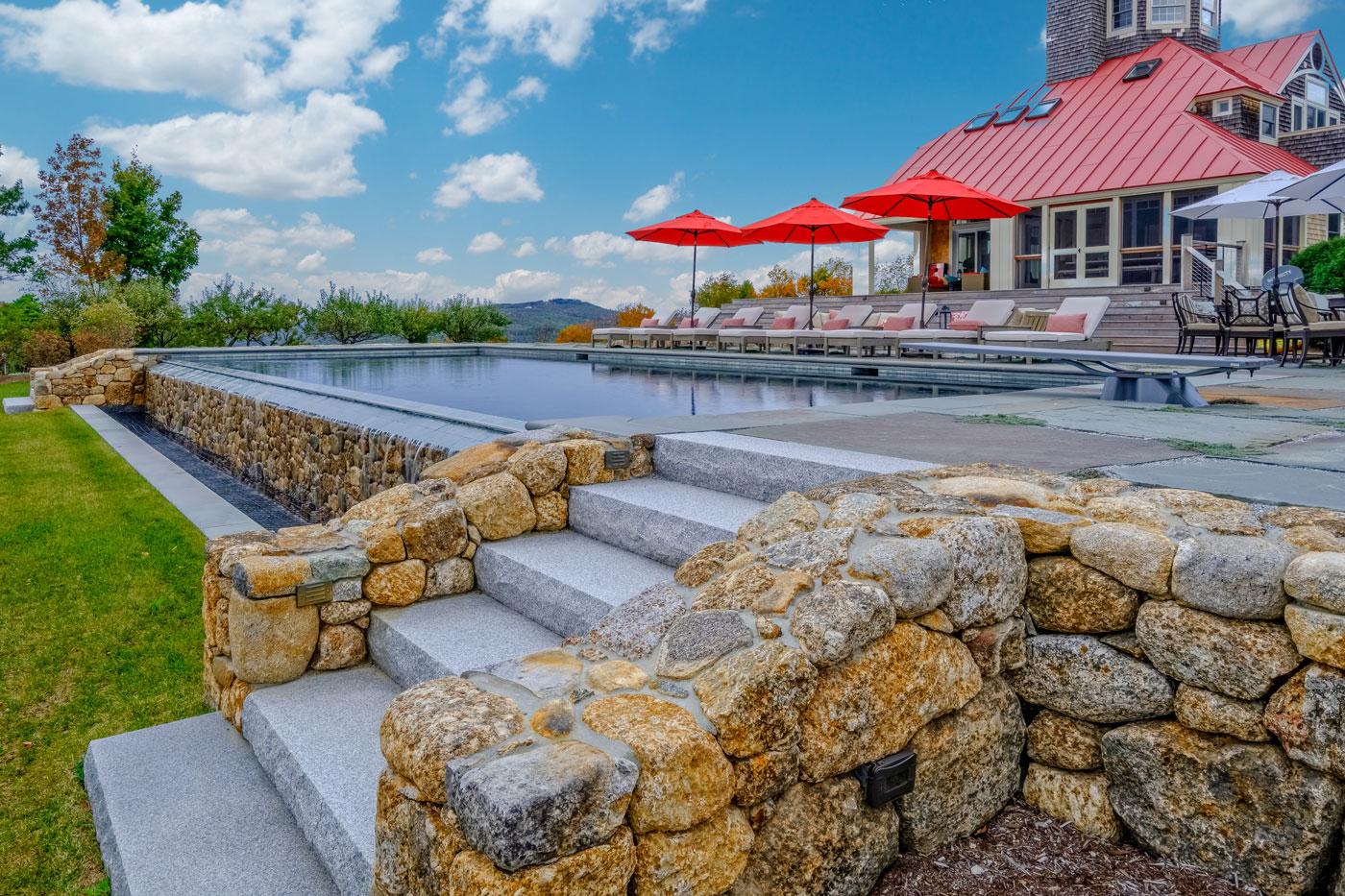 Pool terrace with a view by high-end landscape design/build firm Pellettieri Associates, Inc.