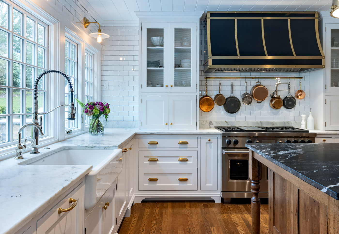 white kitchen with white tiles on the wall and countertops
