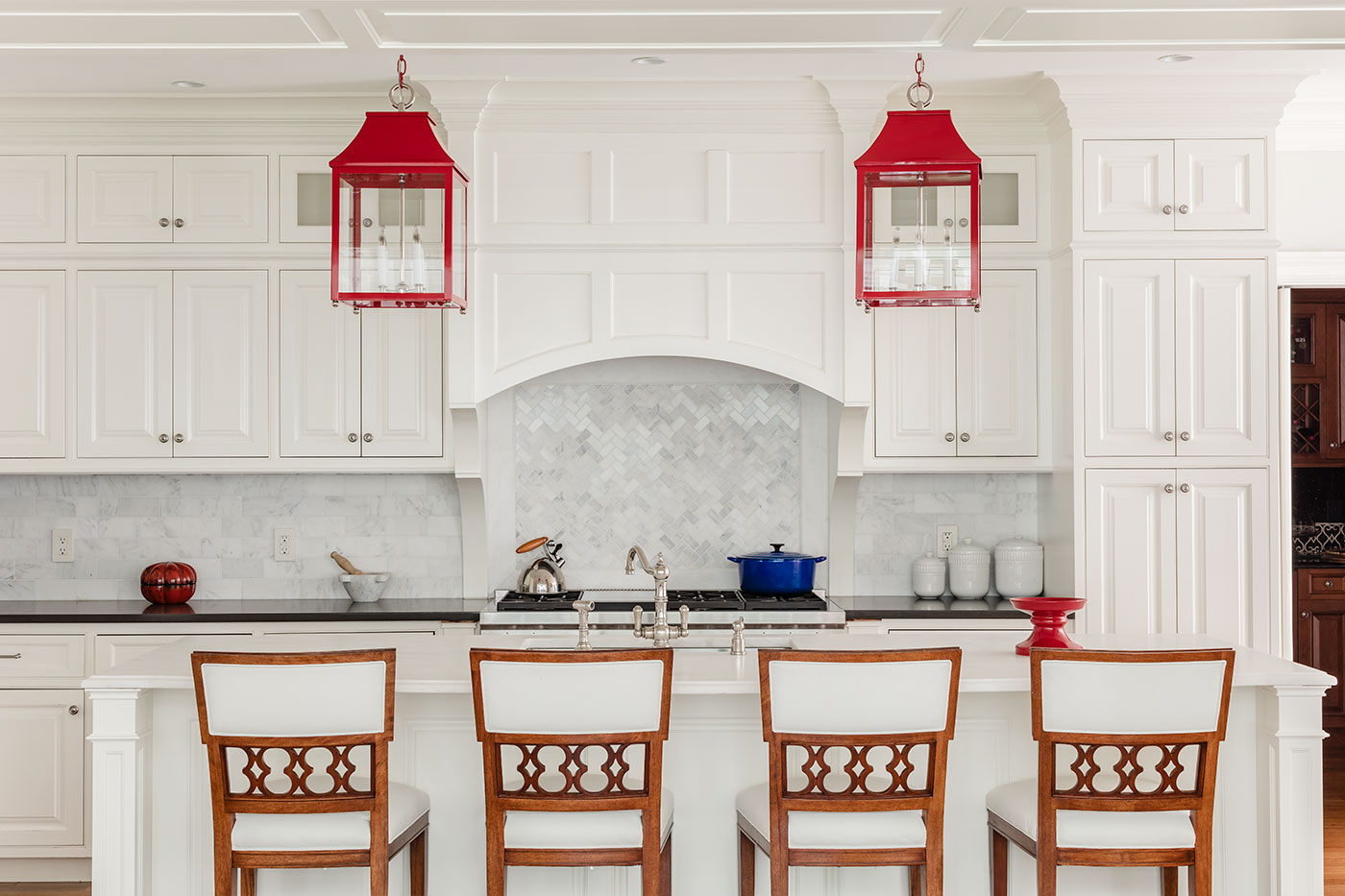 High-end red, white and blue kitchen design by Carter & Company Interior Design