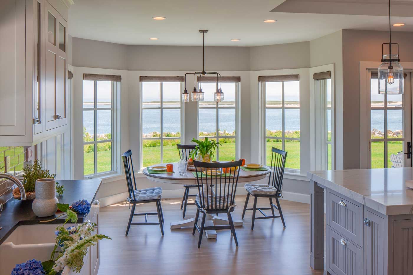 Dining area with big window and view of the ocean
