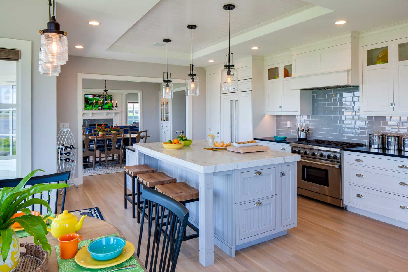 custom white kitchen with big bar in the center