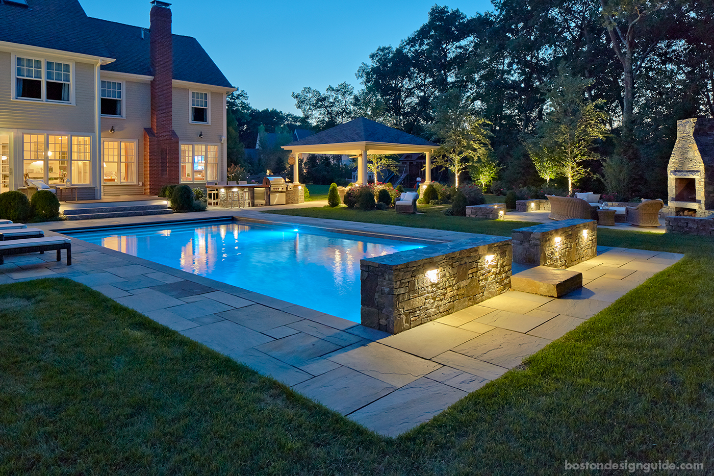 Pool terrace at night designed by a Blade of Grass