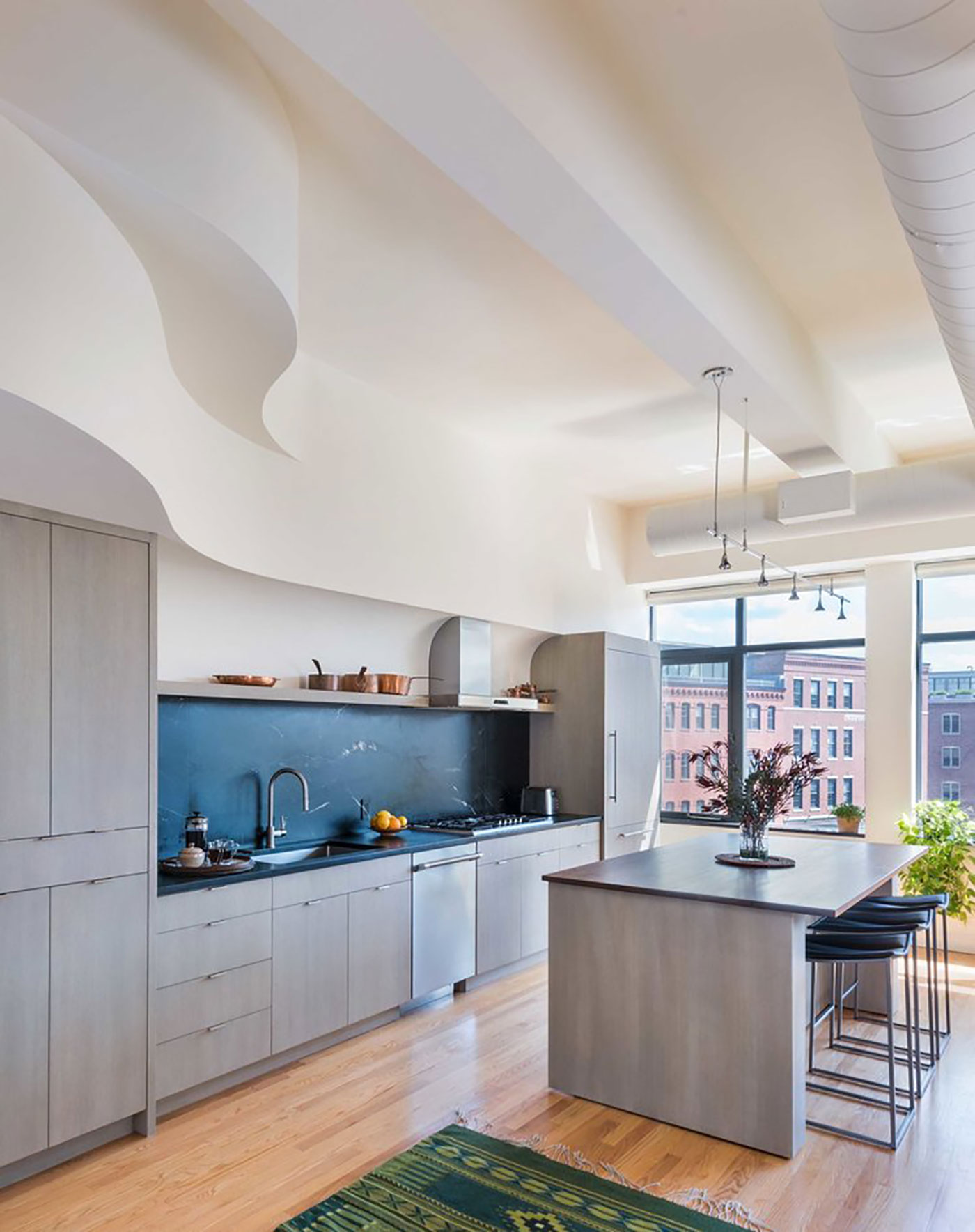 Contemporary makeover for an artist's loft kitchen