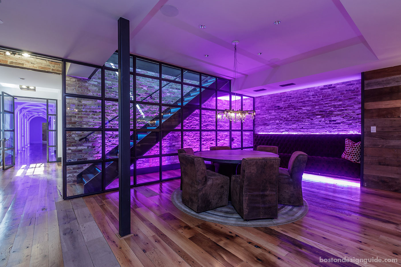 Sitting area in a party barn with violet light, designed by BPC Architecture