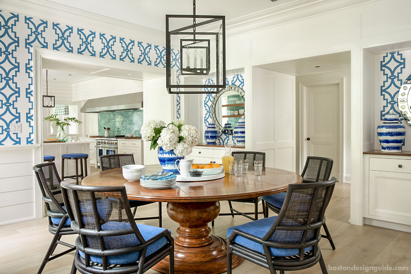 Casual Cape Cod blue and white dining room with bold patterns