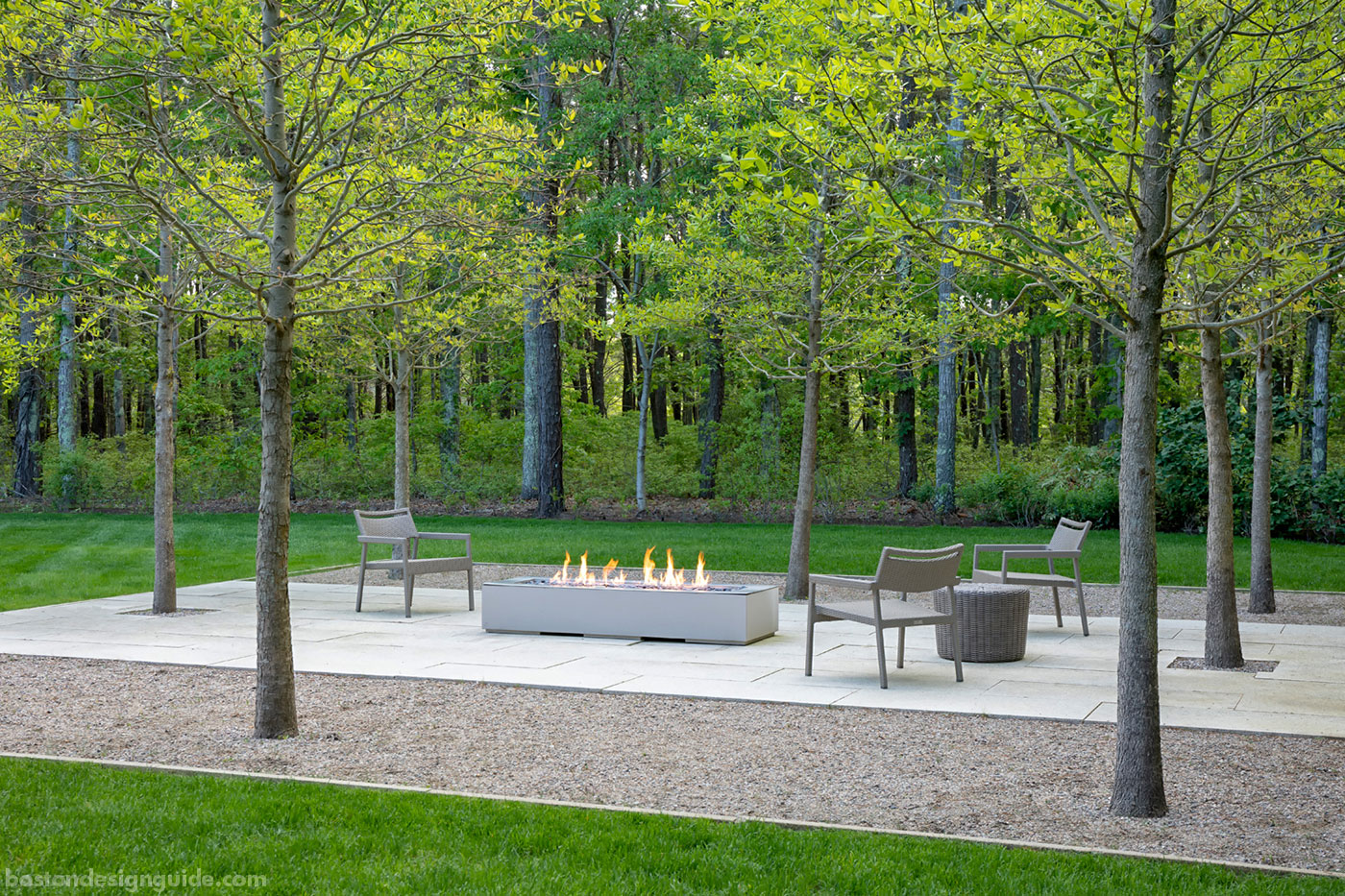 Contemporary grove-side fire feature for a Cape Cod landscape