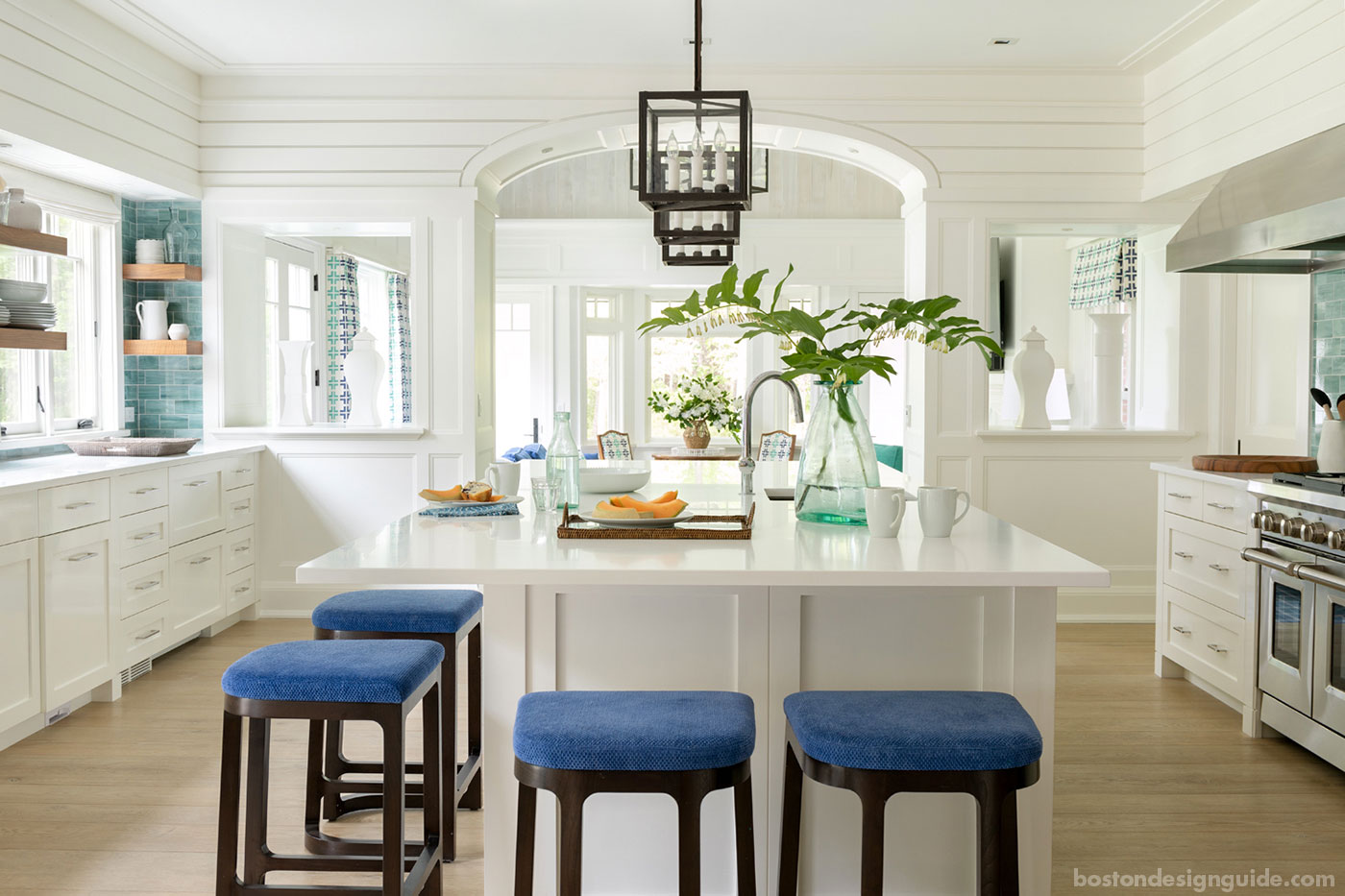 A coastal Cape Cod kitchen within a home designed to house two families