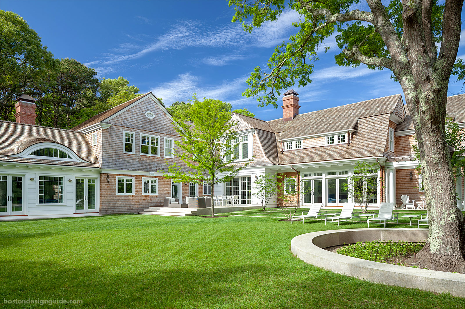 Gambrel Shingle Style Cape home designed by Catalano Architects and constructed by Travis Cundiff Associates, Inc.