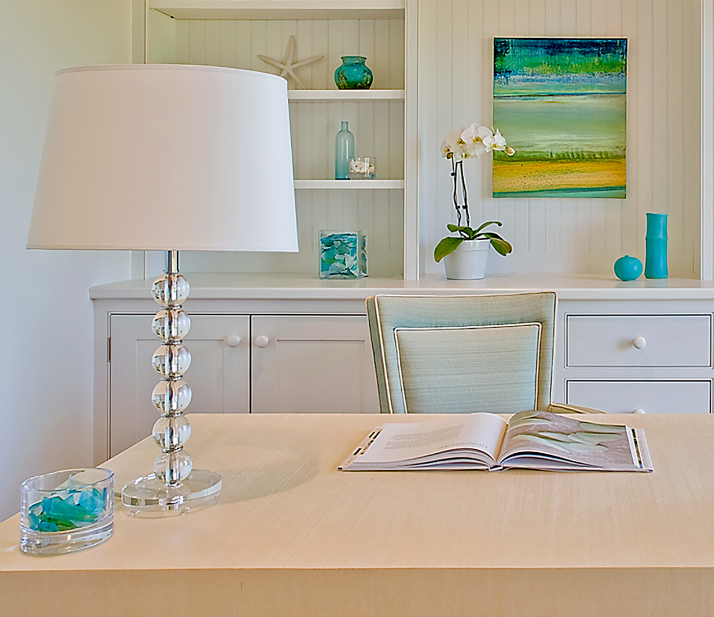 Crisp home office with pops of turquoise by Carter & Company