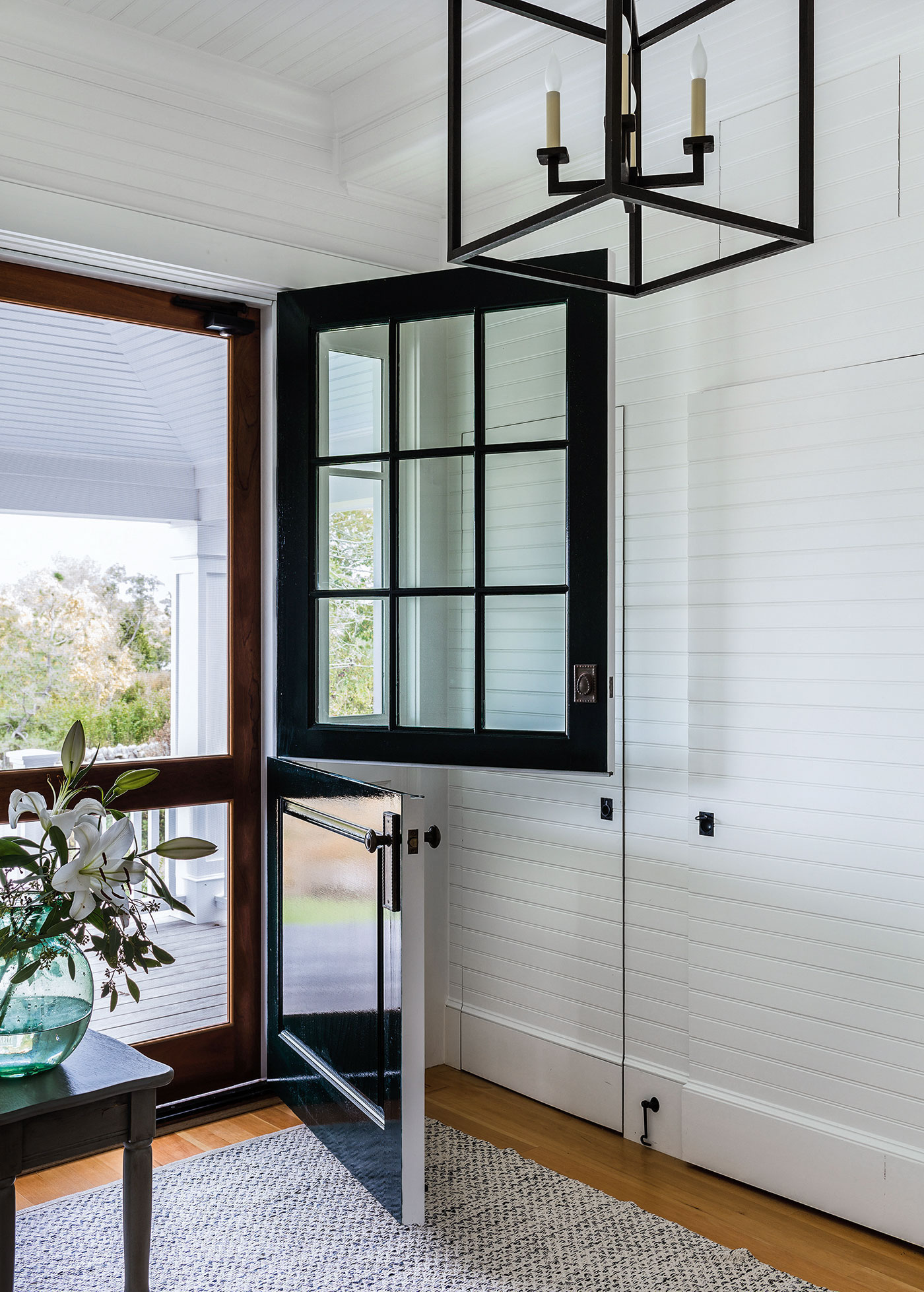 A Dutch door front entrance to a Cape Cod renovation