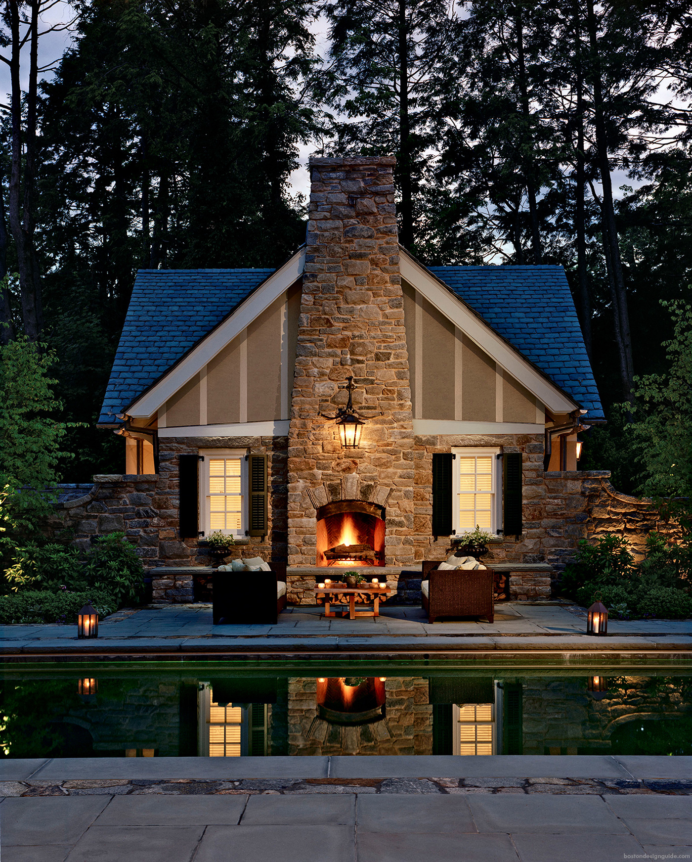 high-end pool landscape design with fireplace