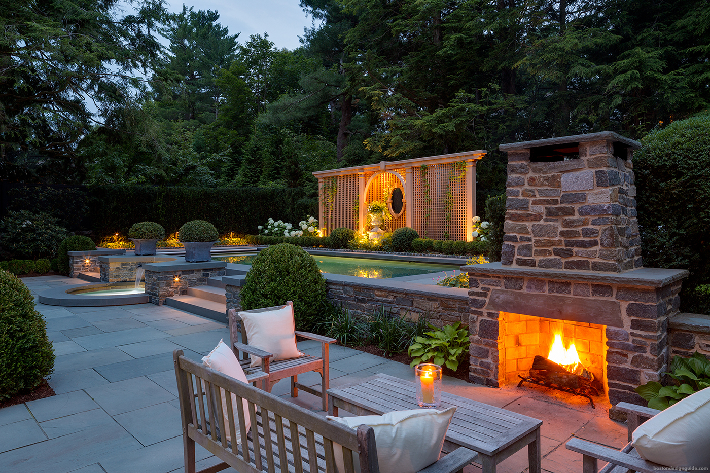 high-end custom pool and outdoor fireplace