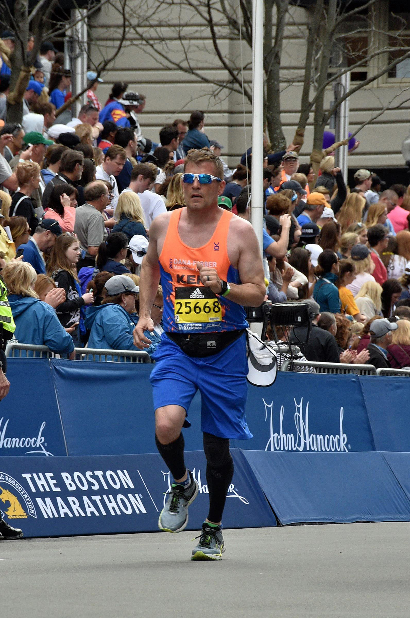 High-end builder running Boston Marathon