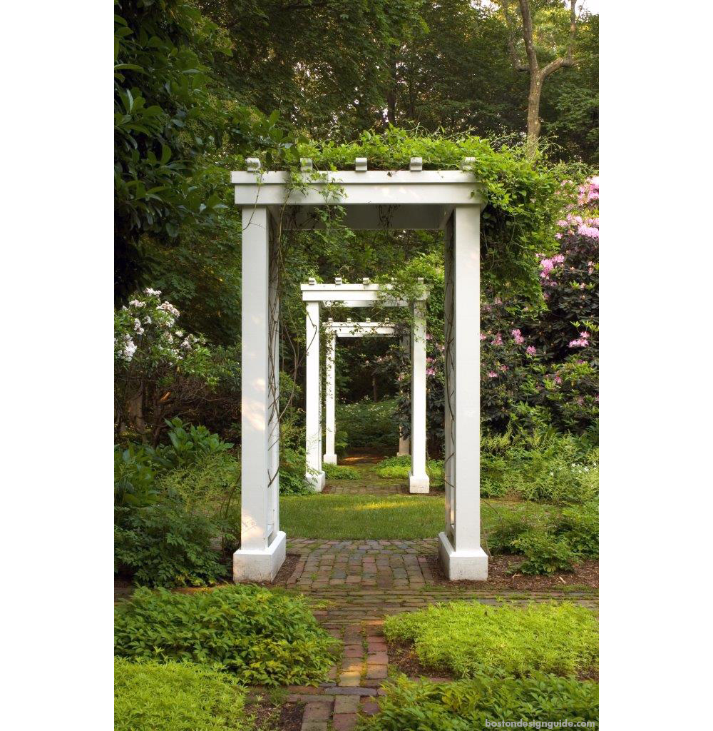 white arbors flowering vines garden brick walkways