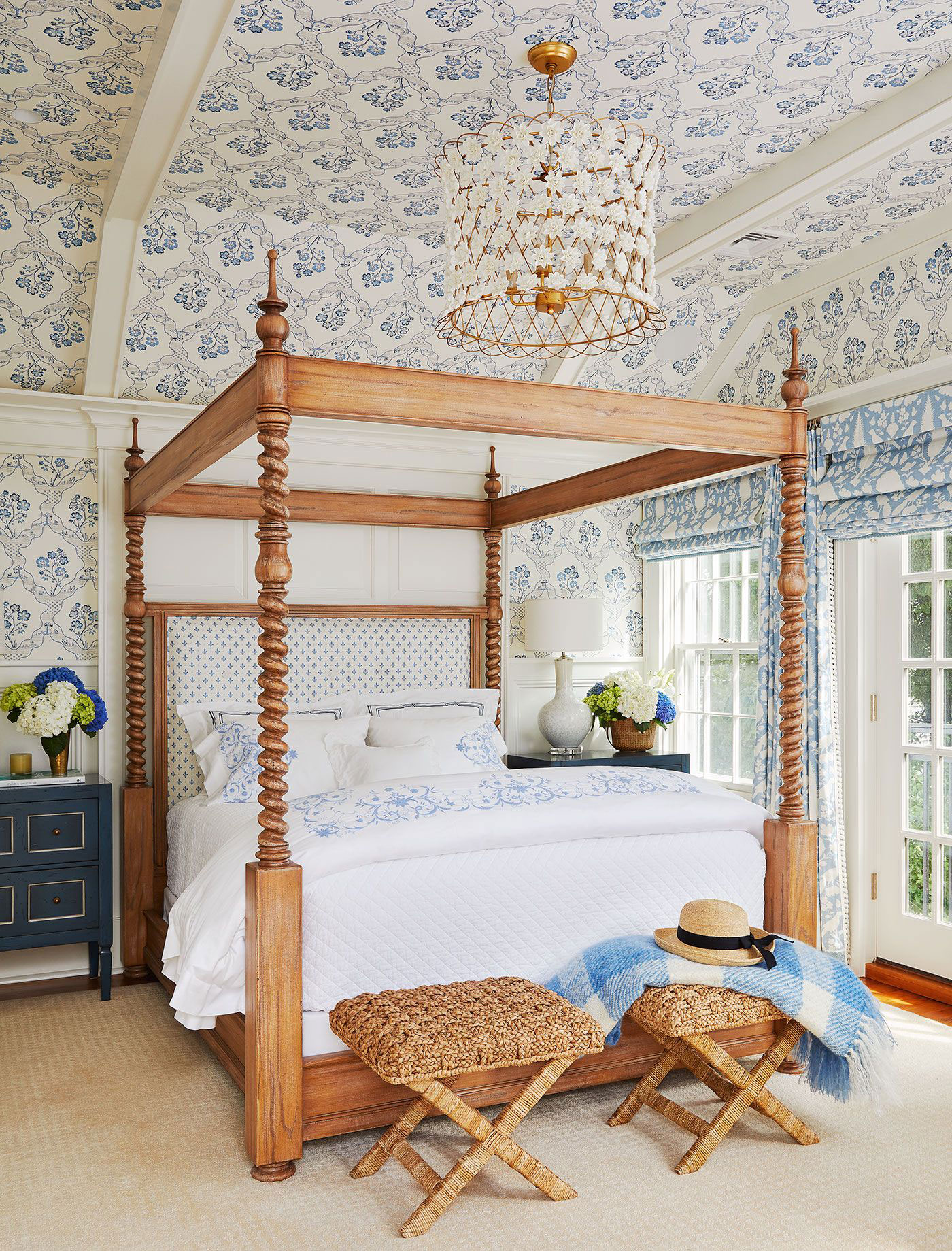 Bedroom with ceiling wallpaper and flower chandelier