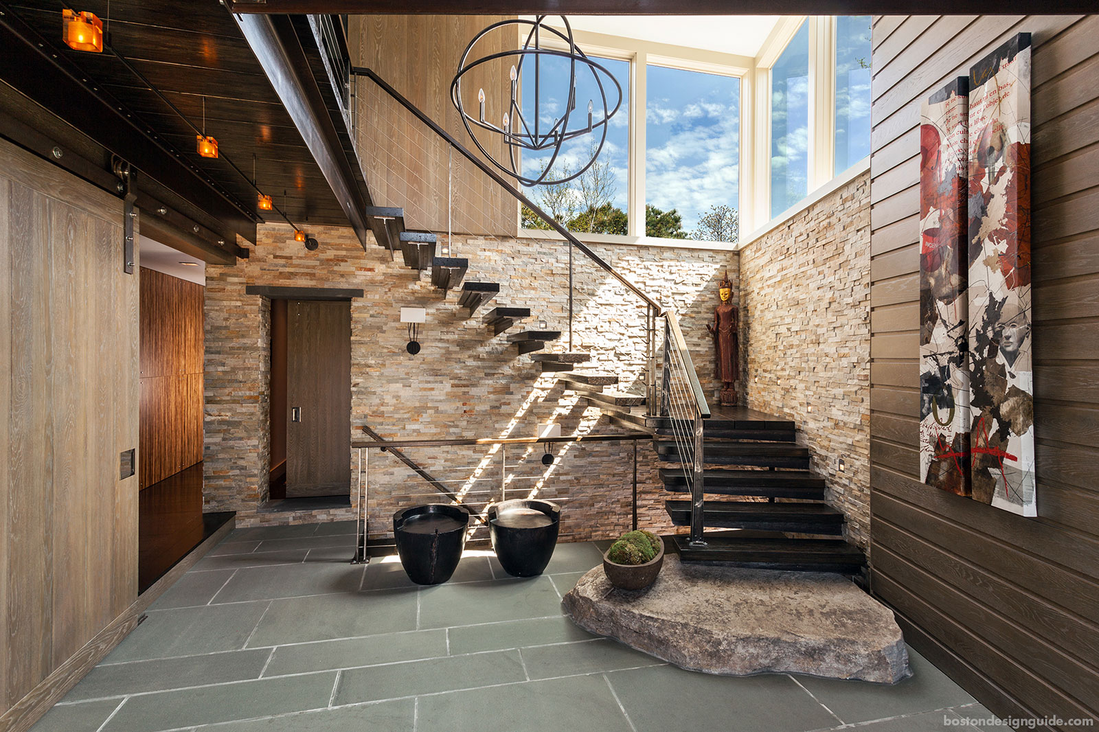 Contemporary staircase by Kistler & Knapp Builders