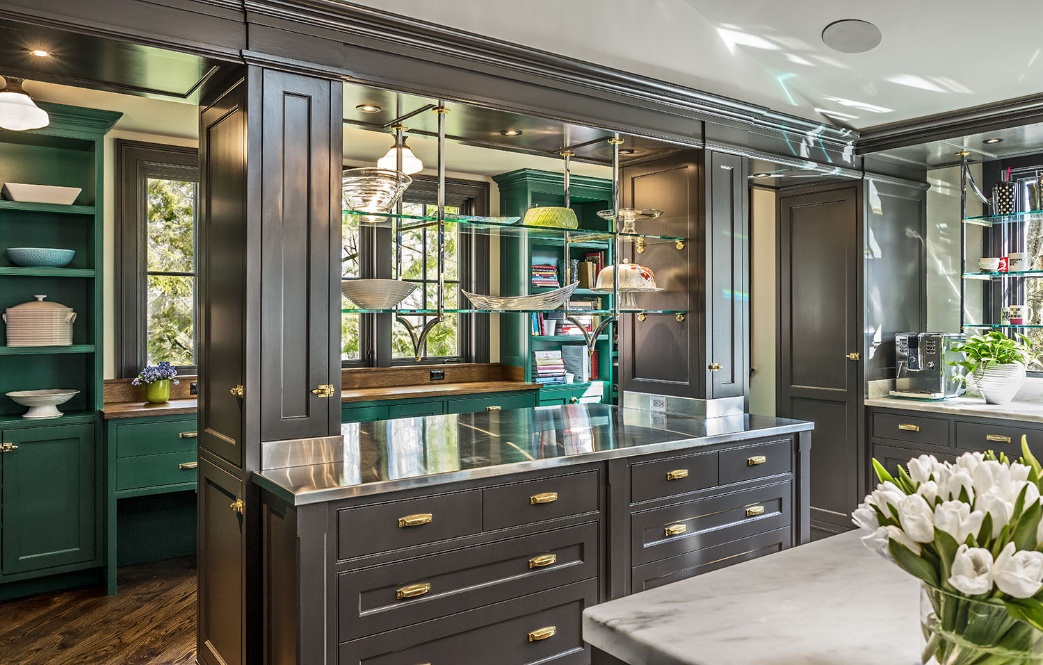 Custom cabinetry adds not only beauty and practicality; it can also create one-of-a-kind living spaces that—quite literally—are tailor made for the homeowner. For the spectacular kitchen shown here, a study in wood and glass work with an array of finishes