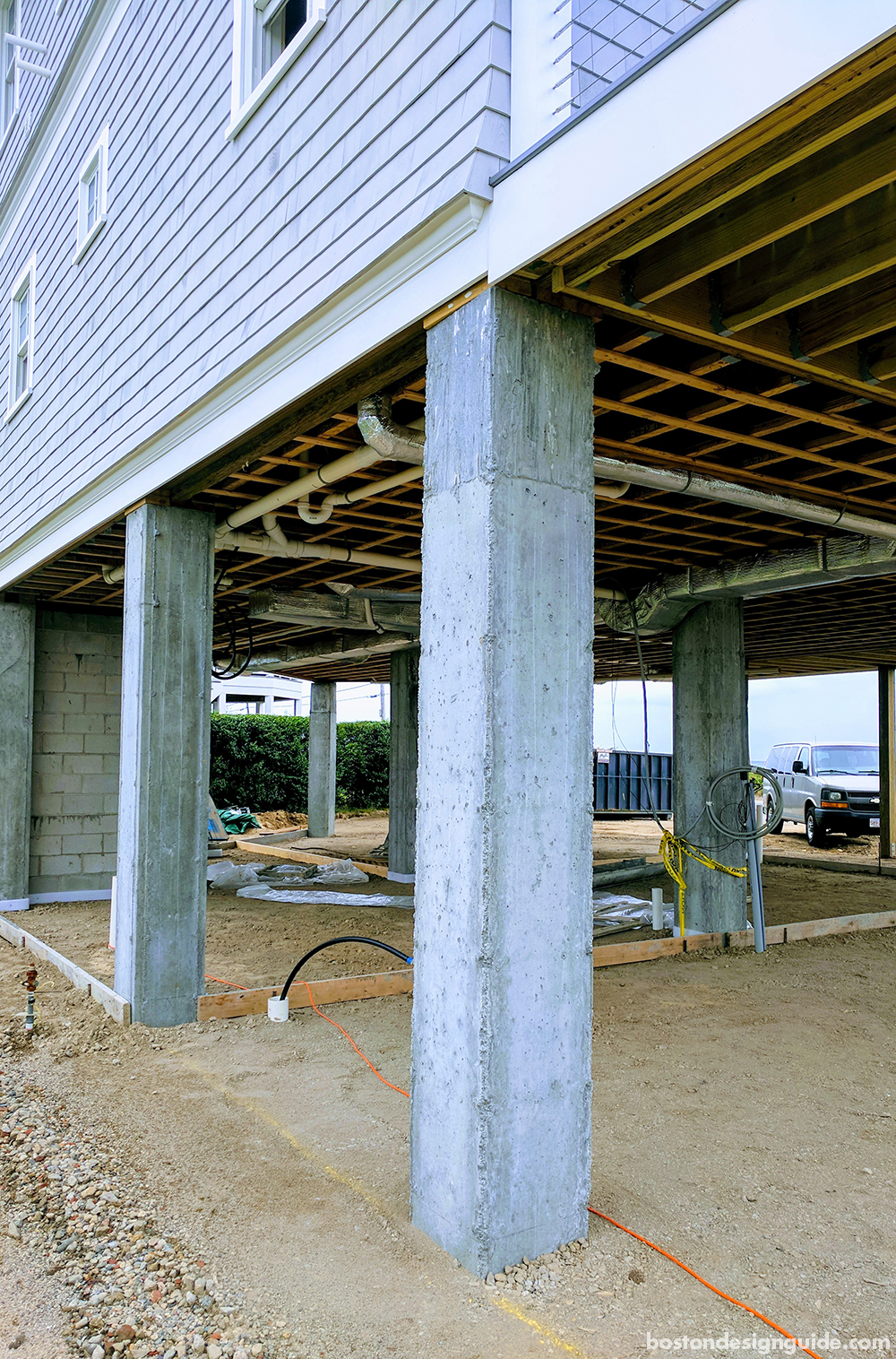 See the construction process of a summer home in falmouth for Building a house on piers