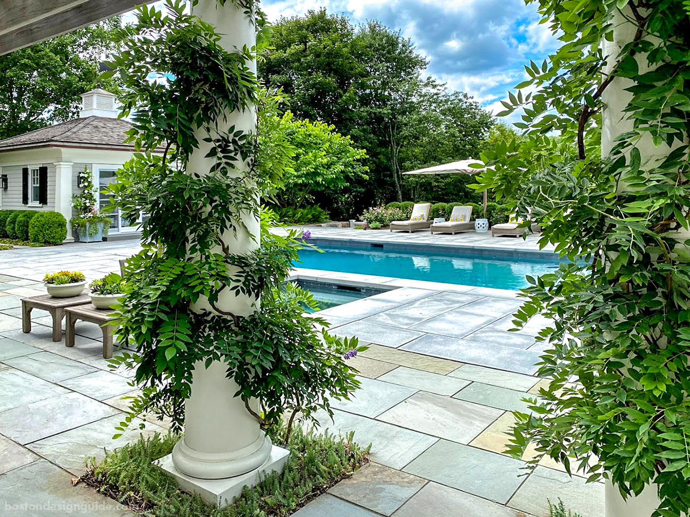 Custom pool, pool garden and pool house constructed by Onyx Corporation
