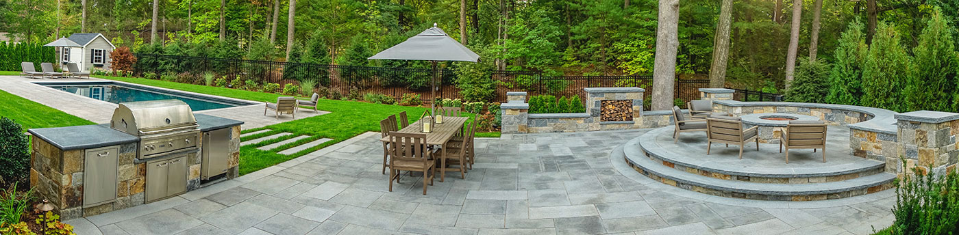 Outdoor kitchen and fire feature terrace by The MacDowell Company