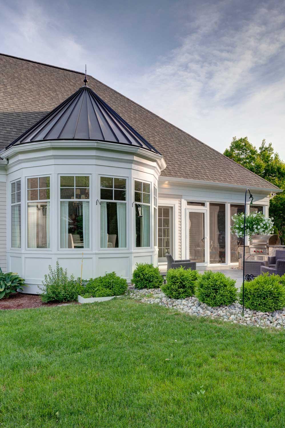 backyard view of home with circular room