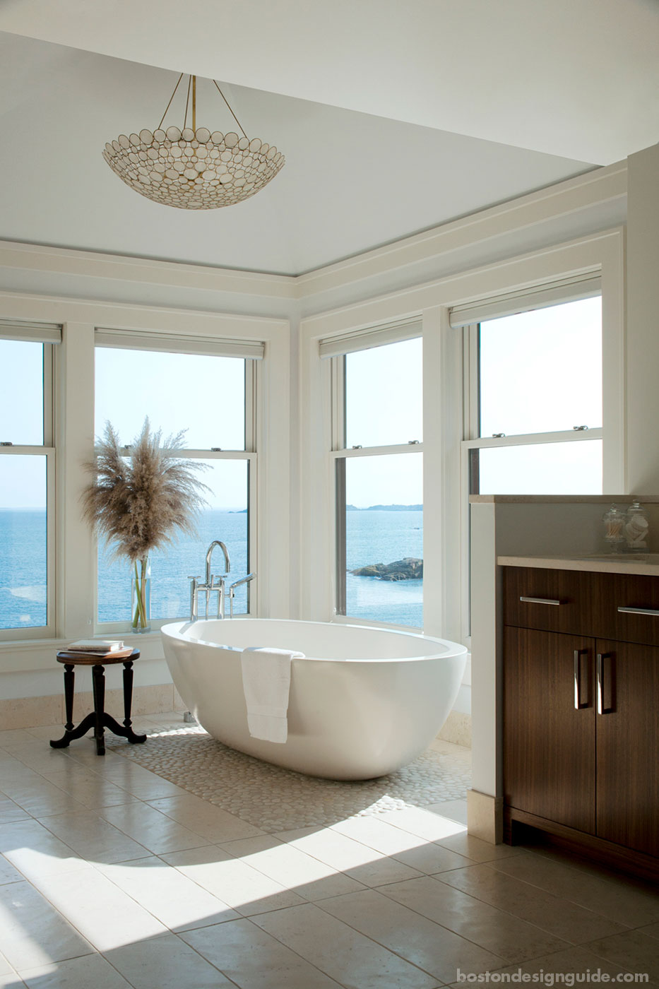Soaking tub with oceanside views in a master bath designed by LDa Architecture & Interiors