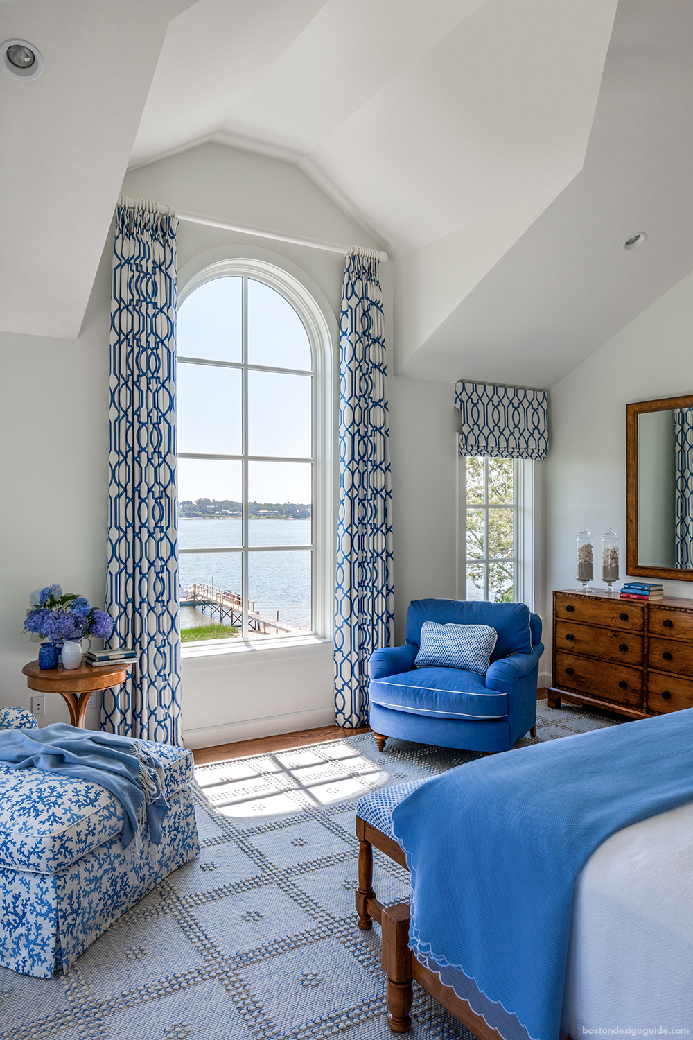 a cape cod shingle style home turns on the charm boston design guide contemporary white blue bedroom interior design in new england cape cod