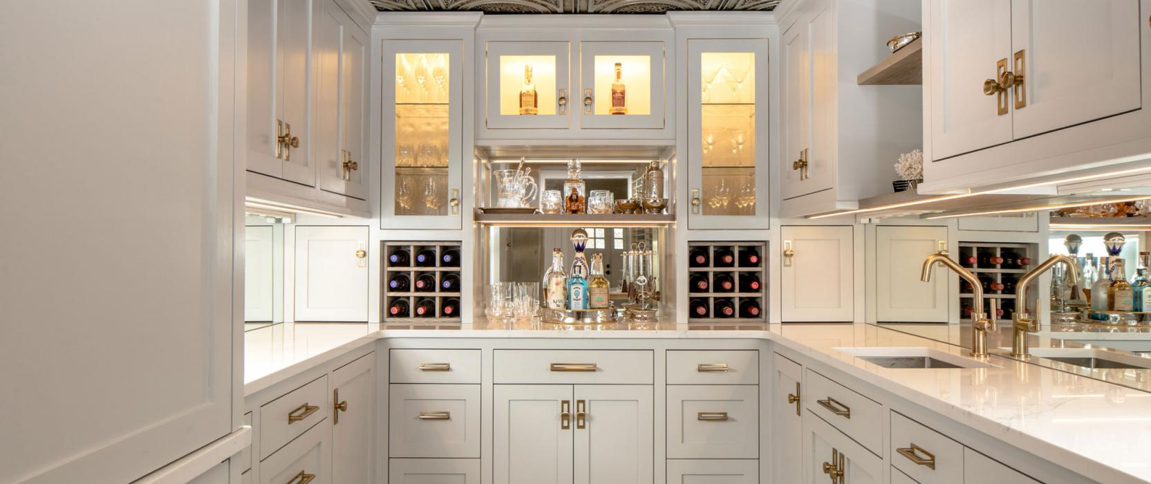 Butler's pantry converted from a bank vault with tin ceilings and white cabinets