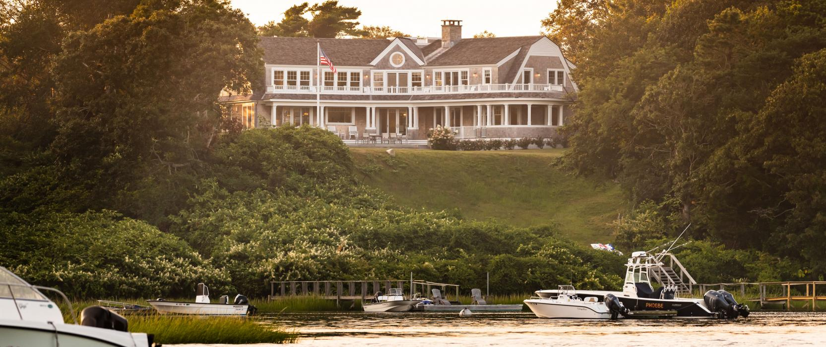 View of cape cod house from the water