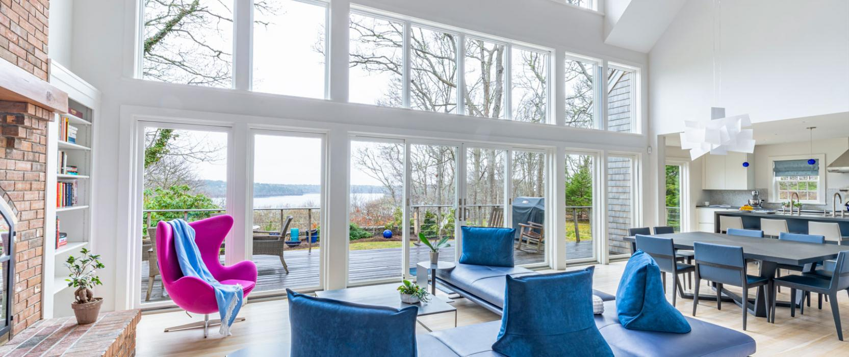 den with big windows and blue chairs