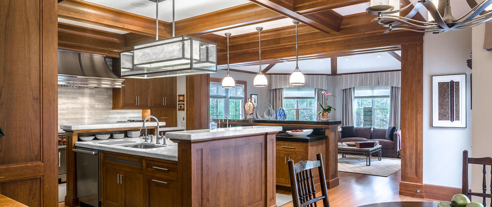 Custom kitchen with multiple islands and cherry woodwork by Fallon Custom Homes & Renovations