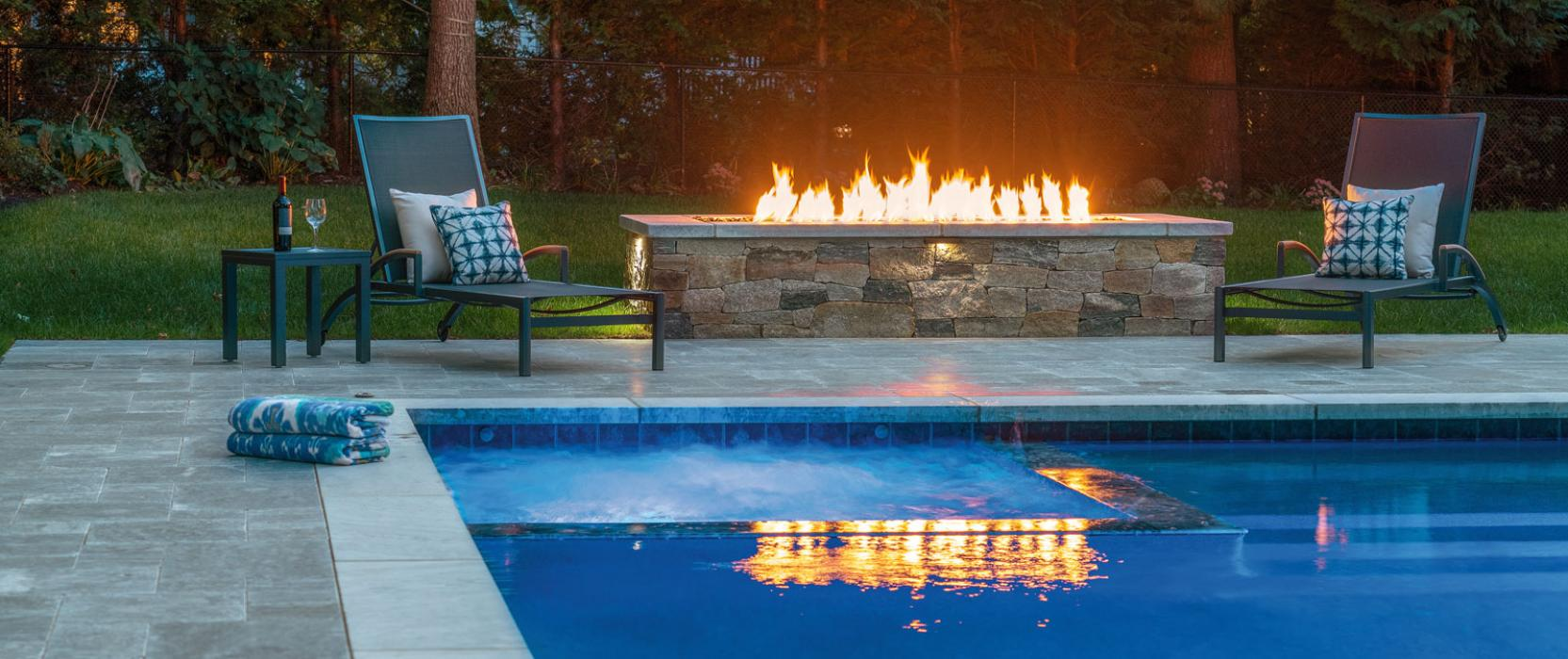 Marble Terrace and Fire Feature by Boston landscape professional Onyx Corporation